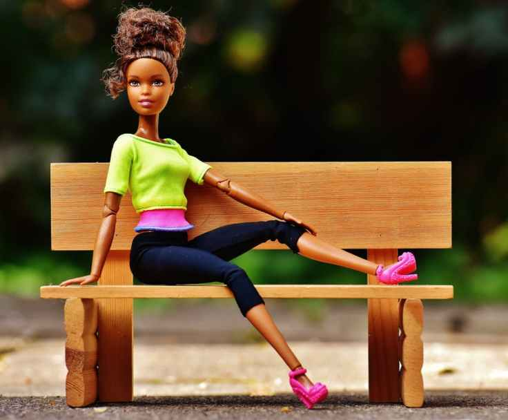 A barbie doll on a bench represents participants in our group