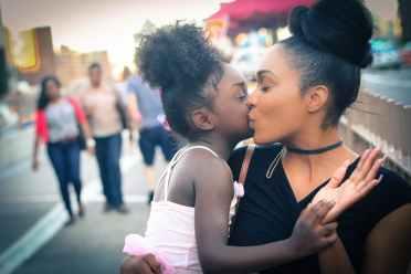 black woman kiss little girl