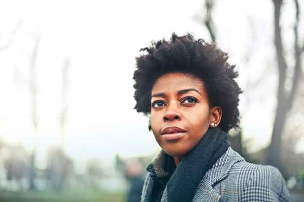 black young woman looking forward