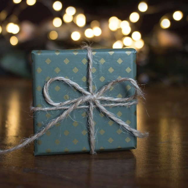 close-up-photo-of-green-gift-box-on-brown-wooden-surface-1681147-1